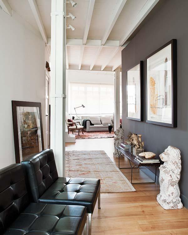 Dark wall, white wall, maple floors.