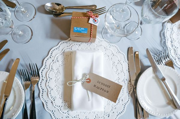 Doilies and a perfectly tied napkin are a place seting for a buffet style wedding English Cotswolds Wedding