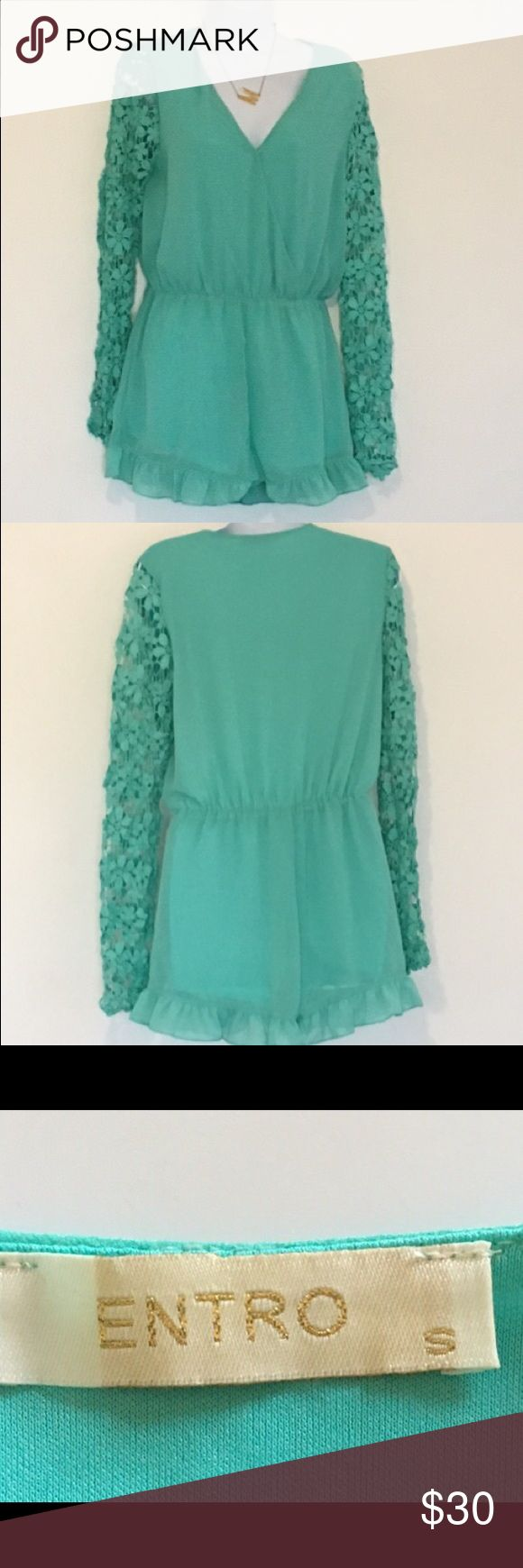 Teal romper with floral see through sleeves Adorable romper! Super flirty and perfect dressed up with wedges and a clutch or casual sandals. Perfect date outfit! Beautiful teal color and ruffle detail on bottom of shorts. Sleeves are see through with floral detail. Made by entro size small entro Pants Jumpsuits & Rompers