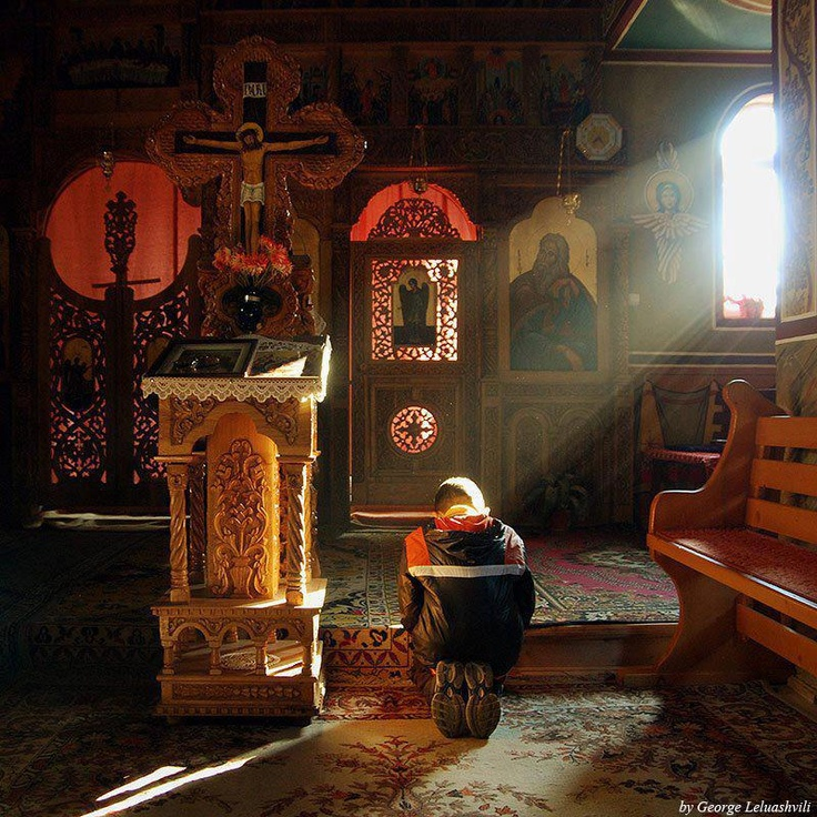 This image of a church and a person who is deep into praying surrounded by sacred objects and images that represent something special and of higher significance, is a good example of symbolic interactionism. This person's behavior is changed comparing to everyday behavior, and the peace and solace that people find at church, can benefit everyday interaction at other places.