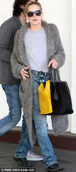 Sharon stone and her Fendi bag...who cares about the bag....look at her sweater!