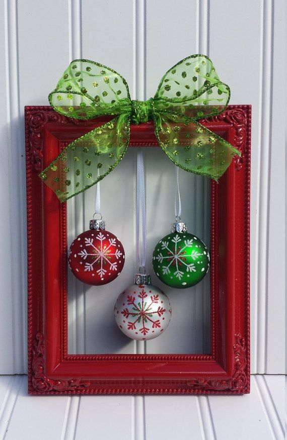 A vIntage picture frame painted in glossy red with a bow and a bunch of ball ornaments hanging in it would become a perfect Christmas wreath.