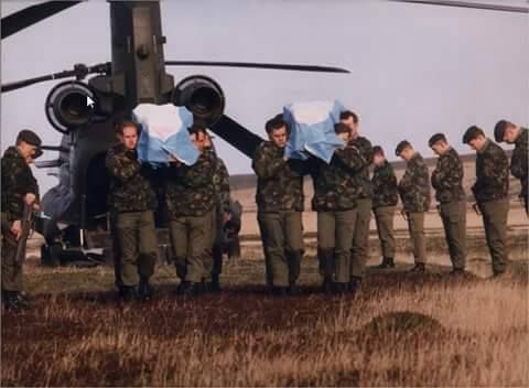 British troops render honors to two dead argentine pilots. Falklands War, 1982.
