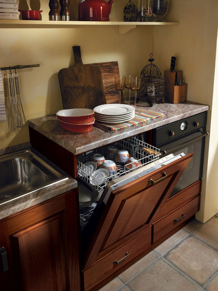 A kitchen in traditional taste able to respond to varying needs and tastes.
