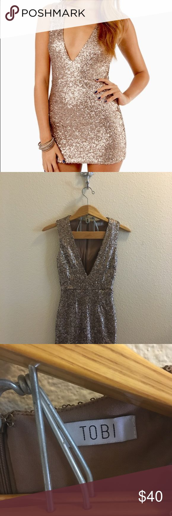 Tobi Gold Sequined Dress Size XS gold sequined clubbing dress by Tobi. NWOT, no flaws or signs of wear. Zips up the back. Form fitting with deep v-shaped neckline.  I ship daily - excluding Sundays and holidays - and I store items in a pet free, smoke free environment. Open to offers; bundles discounted! Tobi Dresses Mini