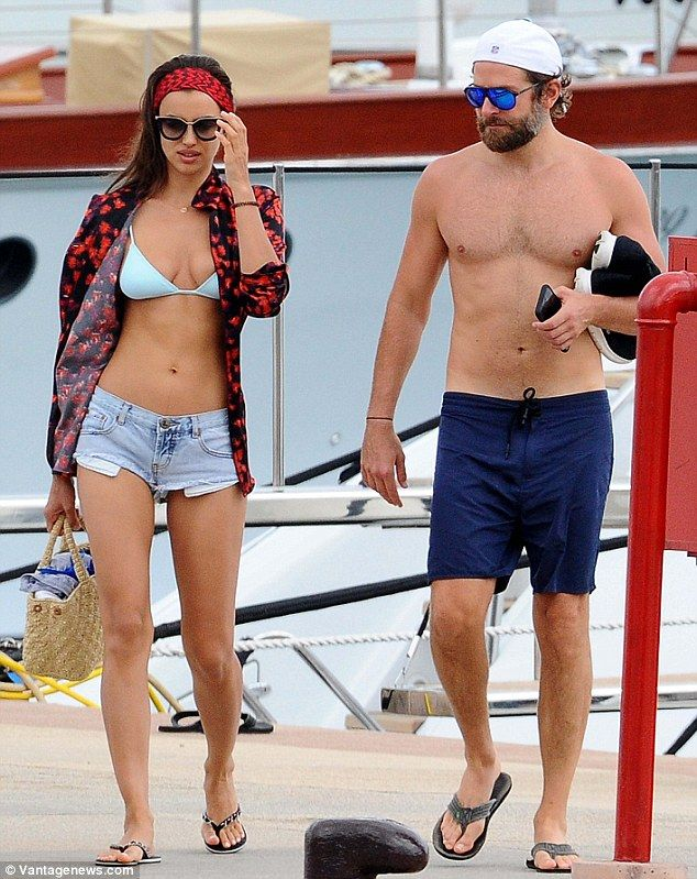 It's all in the bag: The Russian beauty toted a wicker beach bag as she strolled along with her handsome beau