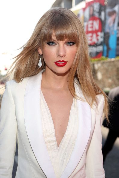 Taylor Swift took the subtler path, smoothing out her trademark curls and opting for blunt bangs.