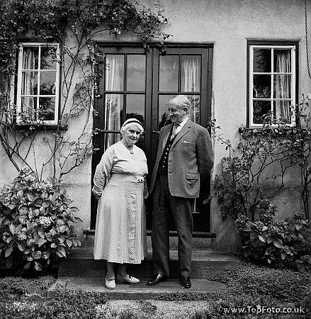 John Ronald Ruel Tolkien photographed in his garden with his wife Edith at 76 Sandfield Road, Oxford 1961