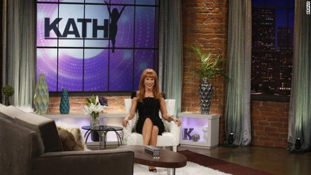 Kathy Griffin exposed brick and city scape softened with curtains