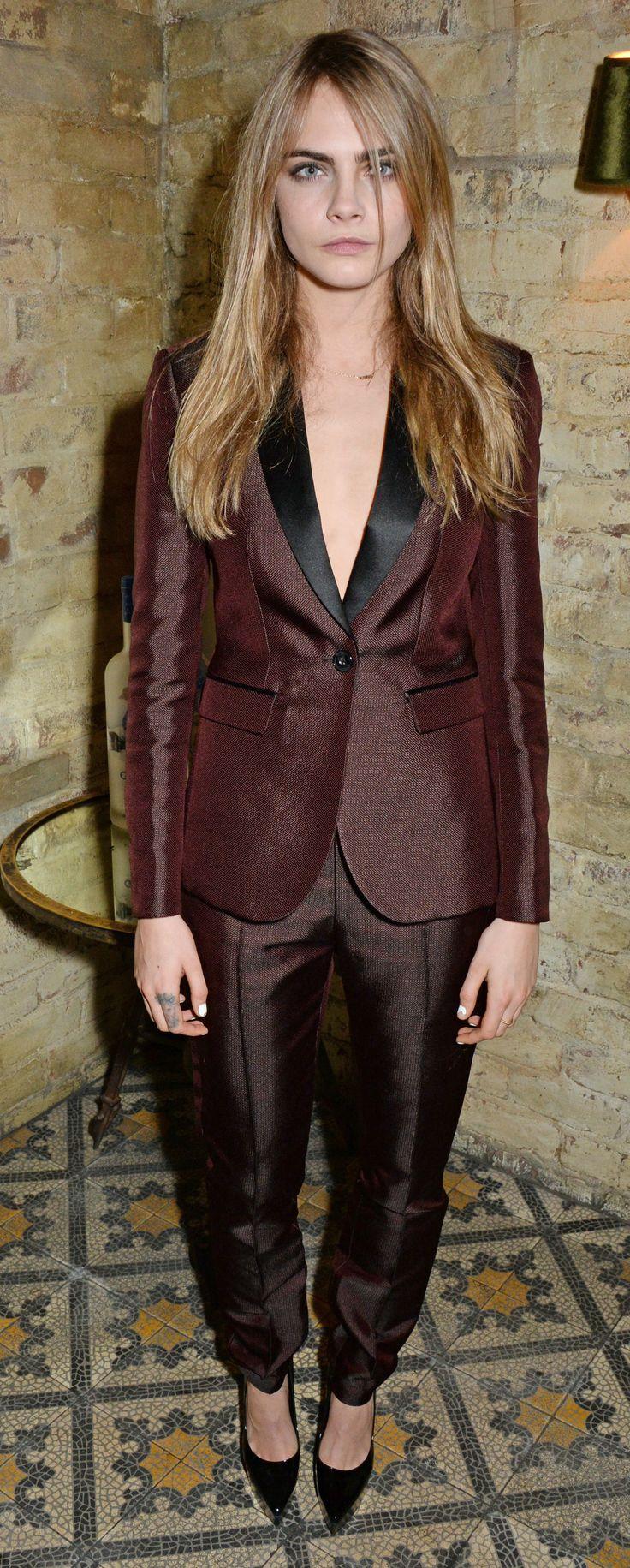 British model Cara Delevingne wearing Burberry tailoring at the Harvey Weinstein pre-BAFTA dinner in London
