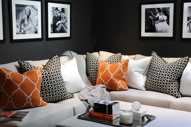 th2 Designs.© We have added some excitement to this dark cinema room with bright orange scatter cushions with geometric designs. The corner sofa provides the perfect comfort to stay in and watch a film with the family.
