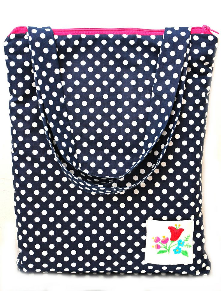 Navy blue polka dot fabric was mixed with old Hungarian embroidery and pink zip which make this bag a very special piece. It is also softly padded with thick fleece. There are pockets inside for your purse and mobile. There is also similar make up bag to go with the bag. :)Size: 33 X 40 cm