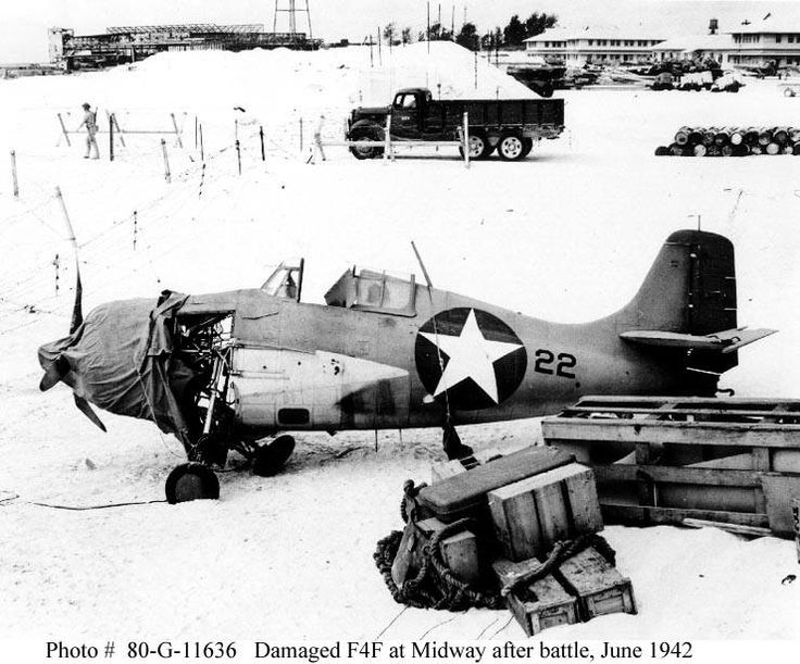 """Damaged and partially disassembled Grumman F4F-3 """"Wildcat"""" fighter on Sand Island, Midway, circa 24-25 June 1942. Source ibiblio.org"""