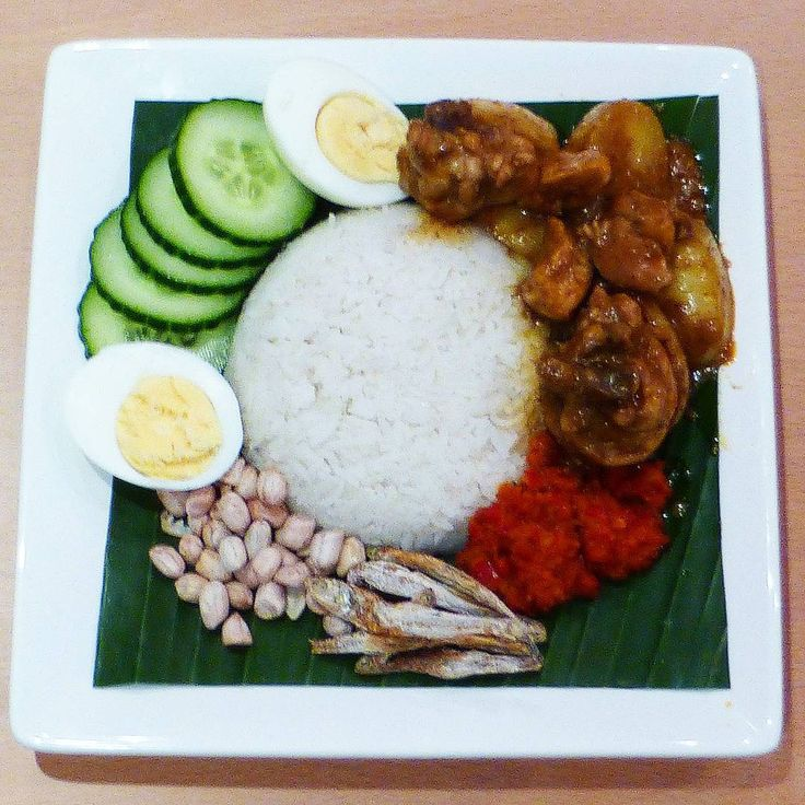 A homemade nasi lemak to celebrate Malaysia Day 2015, with coconut rice, yellow chicken curry, a spicy sambal sauce, fried ikan bilis (anchovies), roasted peanuts, cucumber and a boiled egg. A feast for the eyes as well as your tastebuds!
