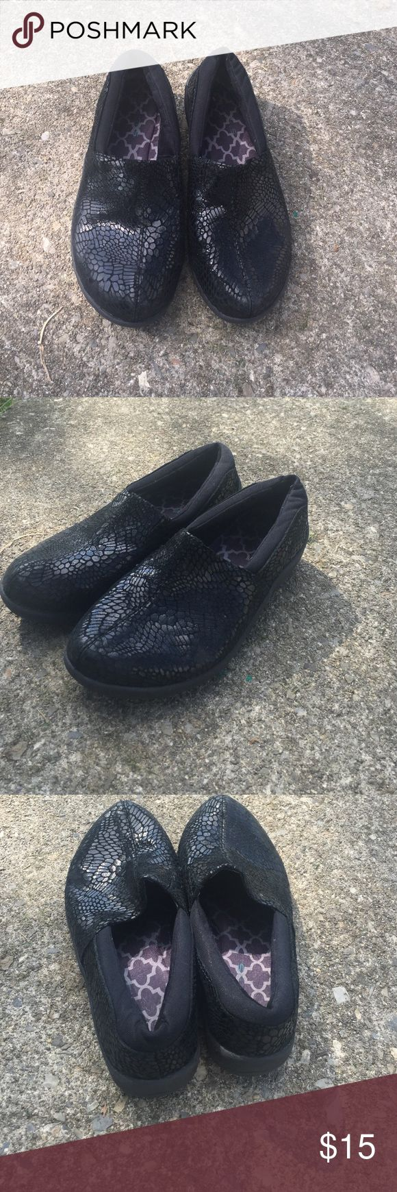 Skechers slip on shoes with lizard print Black leather upper lizard print comfort shoe. Extremely comfortable gently used Skechers Shoes Flats & Loafers