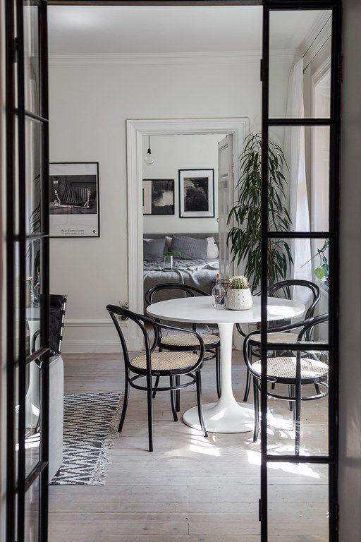 """Black muntins and chairs make this space """"pop"""""""