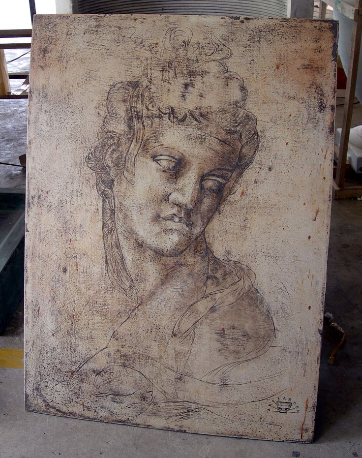 This Image is cast in the cement pannel !  GRC 4 mm thick . the image was scratched into Plaster and a mold taken ! when the cement is cast the image can not be seen until stained with Transparent iron oxides pigments