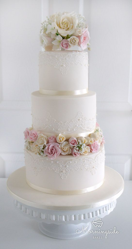 Wedding Cakes 3 tier wedding cake with edible lace, sugar rose bouquet and rose buds separator.