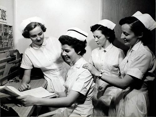 A German, a British, and a French nurse working alongside a Canadian nurse at l'Hôtel-Dieu , 1950 ca by Century 21 Champ Realty -Bill Stevenson, via Flickr