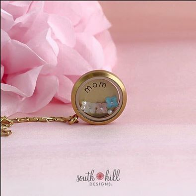 Show your Mom how much she means to you by surprising her with our gorgeous Mother's Day locket. Our Large Matte Gold Locket with Gold Elongated Cable Chain is filled with our long-awaited German Frosted Flowers in Sky Blue, Mint Pearl, and Rose Pearl, and topped with a pack of glistening Vanilla Pearls. It's beautiful and timeless… just like she is! http://SouthHillDesigns.com/TammyTamayo