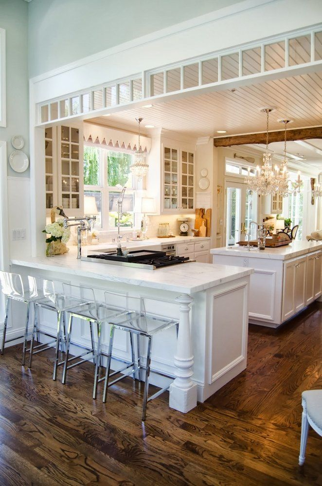 Beautiful kitchen! The light floods the room! The white clean cabinets and sparkling chandelier make all the difference. Love!