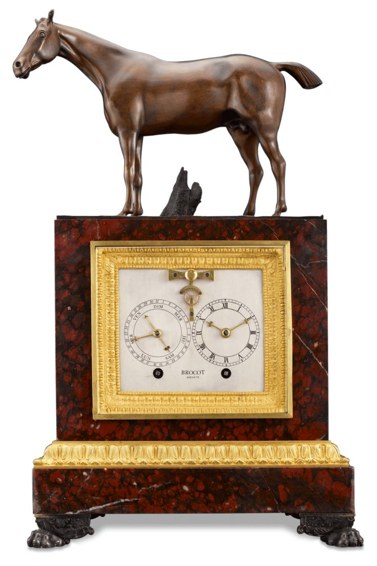 This rare Napoleon III clock by  Brocot combines mechanical brilliance and artistic skill. Crafted of rouge marble and patinated bronze the clock also incorporates a calendar. A fantastic equine bronze sculpture complements this exceptional timepiece ~ Mantel Clock, Antique French Clock, 19th Century Clock, Luxury Timepiece, Historical Timepieces ~ M.S. Rau Antiques