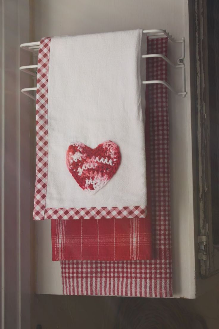 Pretty red kitchen towels....this would really brighten up a kitchen.
