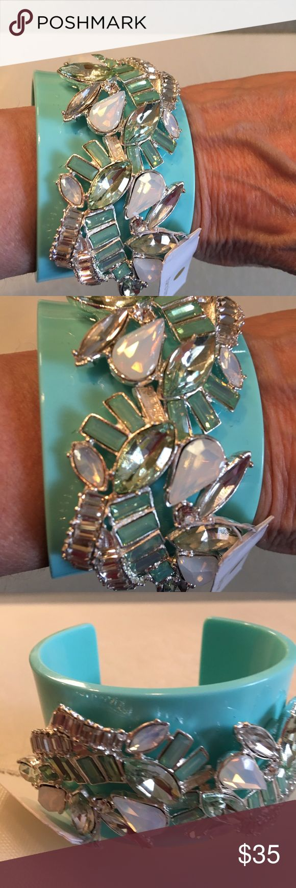 """NWT Gorgeous Statement Cuff This gorgeous Tiffany blue statement cuff is embellished with large crystals of different sizes and shapes: pear, baguette, marquis, etc. Cuff itself is approx 1.75"""" wide and is made of ceramic or very hard plastic. It is very substantial. This bracelet will get you noticed and can become your signature cuff. Jewelry Bracelets"""