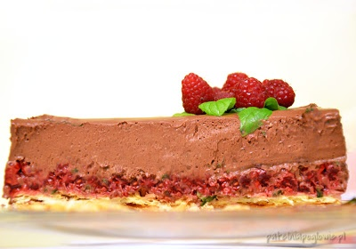 Chocolate cake with raspberries and mint.