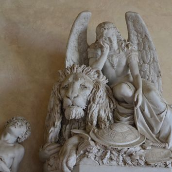 ANGEL & LION MARBLE SCULPTURE - The Franciscan Basilica di Santa Croce (Holy Cross) in Florence is the burial place of some of Italy's most illustrious men, such as Michelangelo, Galileo, Machiavelli, and Rossini, and is thus known as the Temple of Italian Glories.