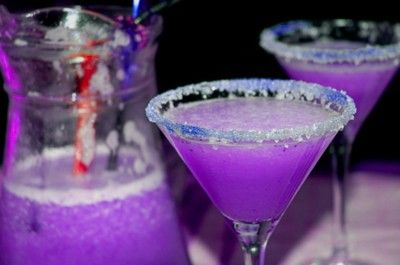 Violet Martini  3 oz Vodka 1 1/2 oz cranberry juice ½ oz blue Curacao liqueur ½ oz sweet and sour mix ½ of soda 7-up  Pour the ingredients into a cocktail shaker and shake gently. Add more blue Curacao if the color isn't purple enough. Serve in a chilled