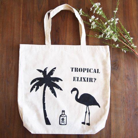 Typical holiday scenario plus a potentially foolish flamingo. Tropical Elixir tote bag by Grafeeq