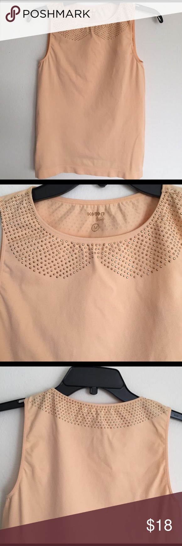 Peach top. NWOT Very cute. Studded from collar . Size M. Stretchy. Koton brand. Made in Turkey. 93% polymide & 7% Elastane koton-Turkey Tops