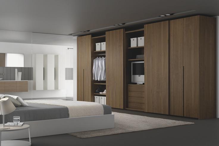 Walnut coplanar wardrobe doors.