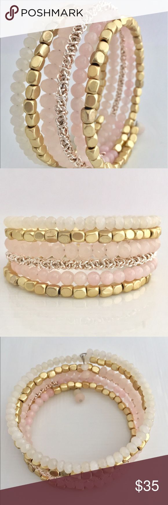 Pink & Gold Stacked Bracelet This design was made to drape elegantly around the wrist for instant evening dazzle or with a cute summer day dress.     D E T A I L S:  •Memory wire is easy to wear and to slip on and off; it keeps its shape beautifully.                              M A T E R I A L S:  • Memory wire, silver-plated tempered stainless steel, 7 in.bracelet • 2mm Light Pink Crystal glass Rondelle Faceted Beads • 4mm Light Pink Crystal glass Rondelle Faceted Beads • 4mm Light Pink…