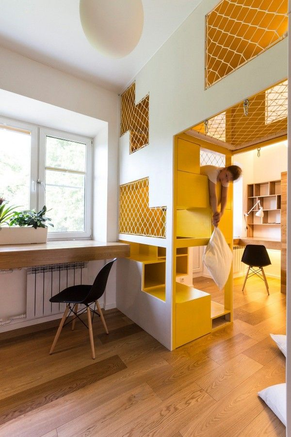 Study desks occupy either side of the climbable divider, demonstrating the necessary balance between work and play.