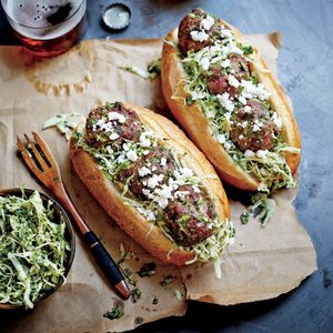 These deliciously flavored meatballs served on hoagie rolls or French baguette rolls will be the new favorite at your weeknight dinner table or your neighborhood football party. The sauce makes plenty for cooking the meatballs, and there's even enough to spoon over the sandwiches for a boost of flavor.