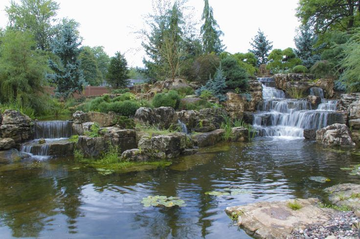 expansive waterfalls and pond in crown point indiana, outdoor living, patio, ponds water features, The main pond receives approximately 120 000 gallons of water per hour from the large waterfall to the right