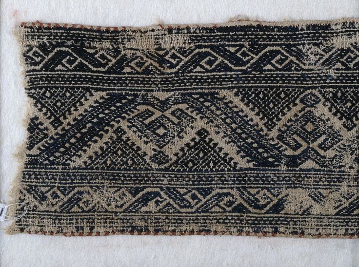 textile fragment with leaf scrolls palmettes and triangles the embroidery on this fragment
