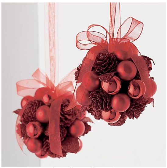 Kissing balls from tinted pine cones and ornaments.