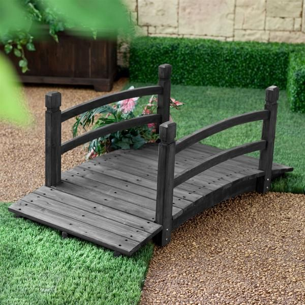 A classic, graceful design and handsome dark brown stain ensure this 4-Ft Outdoor Garden Bridge with Hand-Rails in Weather Resistant Dark Wood Stain will create