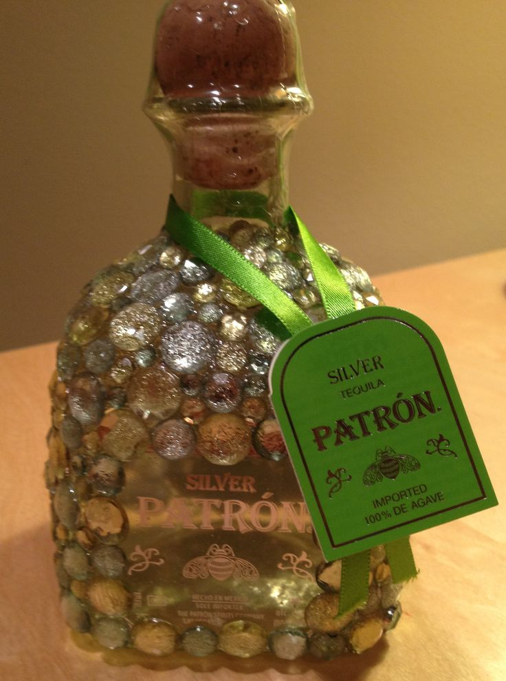 Birthday gift idea: Bedazzle your friends favorite bottle of liquor. This is my finished product. The linked tutorial was helpful. Supplies purchased at Hobby Lobby.
