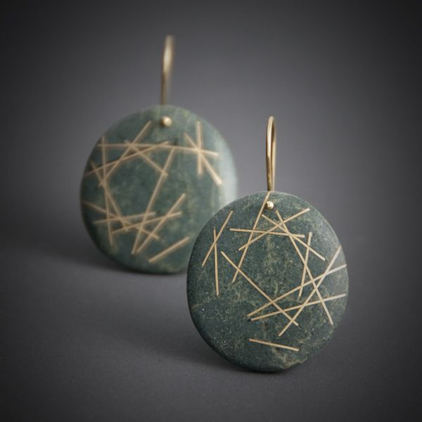 """Undone Earrings"" were inspired by a very short lived work created by artist Andy Goldsworthy where he assembled an inverted nest-like structure out of driftwood that was lifted and slowly deconstructed by the tide- seen in the documentary Rivers and Tides. Inlaid reclaimed 18k gold, floats and disperses in a sea of green."