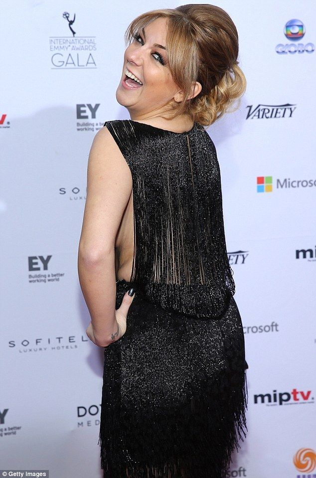 Very little black dress: Sheridan Smith flashed a glimpse of the side of her boob on the red carpet at the International Emmy Awards in New York on Monday evening