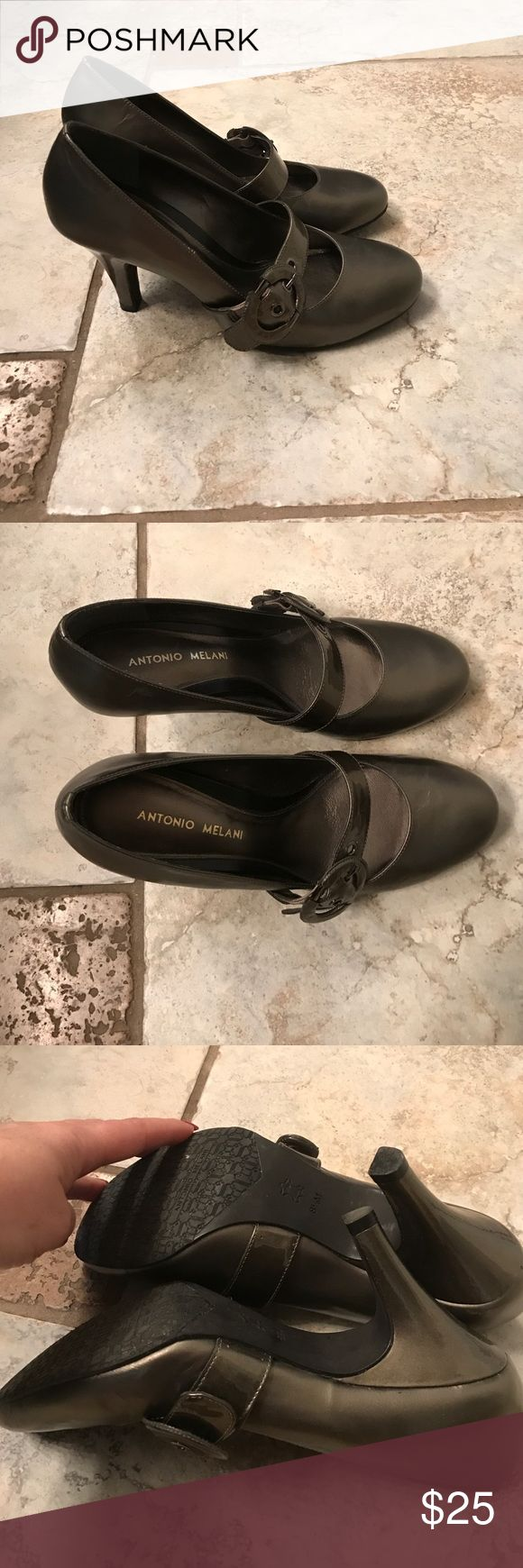 Antonio Melani slip on high heels- with buckle. Beautiful Antonio Melani slip on high heel shoe. With buckle. Color is a Silver/Copper or grayish-- hard to describe, very pretty. Never worn, no damage. ANTONIO MELANI Shoes Heels