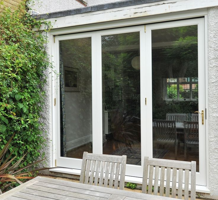 New bespoke timber bi-fold door, external view, manufactured and installed by The Sash Window Workshop