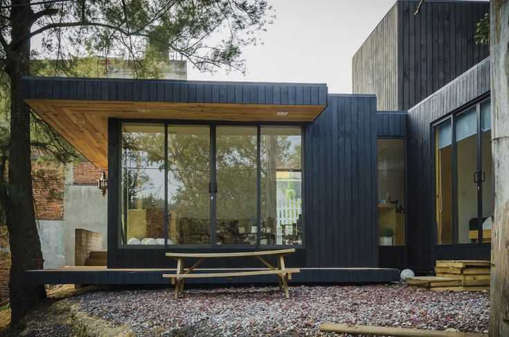 The Black Cabin by Revolution Architects, contemporary cabin in Mexico City, quiet cabin retreat in Mexico City, Mexico city contemporary residential architecture, passive ventilation in a cabin, modular cabin, sustainable cabin, green roofed cabin
