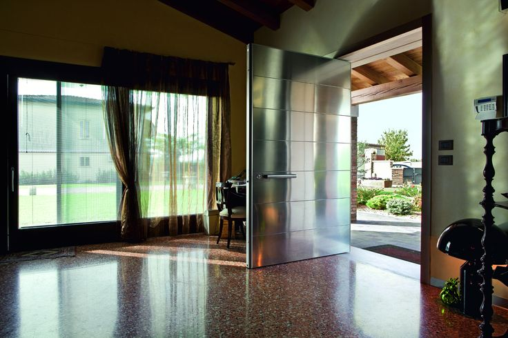 Modern pivot door in stainless steel by Oikos Venezia