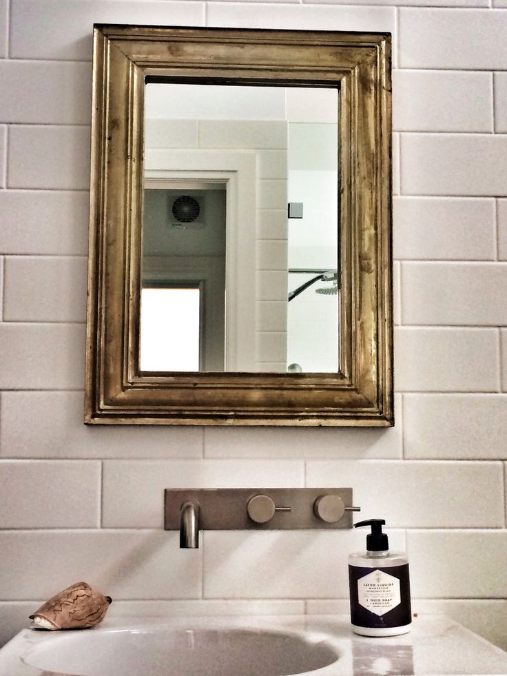 Bathroom mirror. Contrast the old with the new for effect