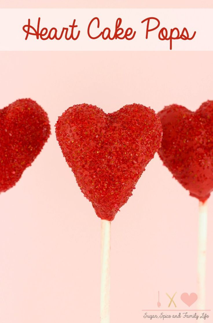 Heart Cake Pops are a cute way to show your love. The heart shaped cake balls are covered in red candy coating and decorated with red sanding sugar. The cake pops are a kid friendly treat that would be great as a Valentine's Day dessert. - Heart Cake Pops